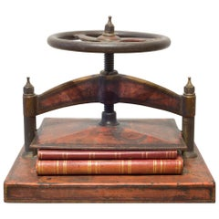 Cast Iron Red Polychromed and Stenciled Wheel Book Press, circa 1930