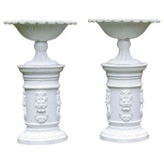 White Painted Cast-Iron Urns on White Pedestals