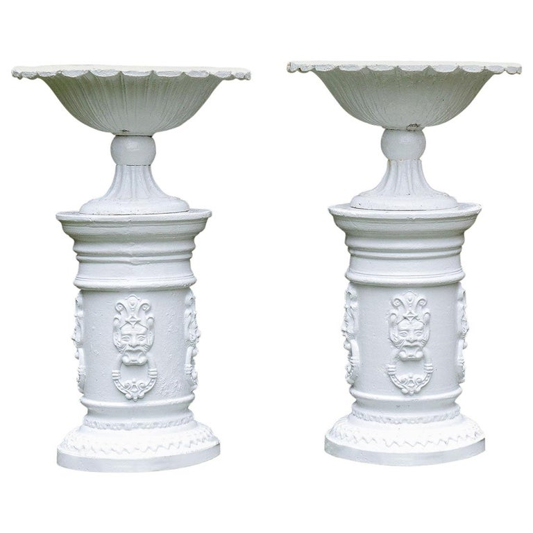 White Painted Cast-Iron Urns on White Pedestals For Sale