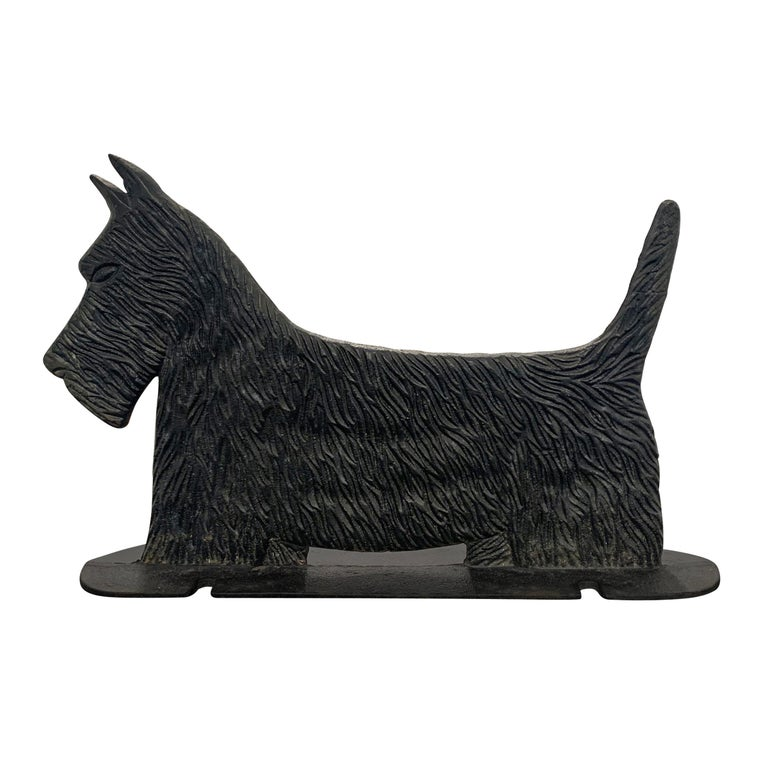 A wonderfully whimsical early 20th century American cast iron Scottish Terrier bootscrape with a fantastic fur texture and strong silhouette. Notice the notches to the base--these were originally used to attach the scrape to a pavement surface in