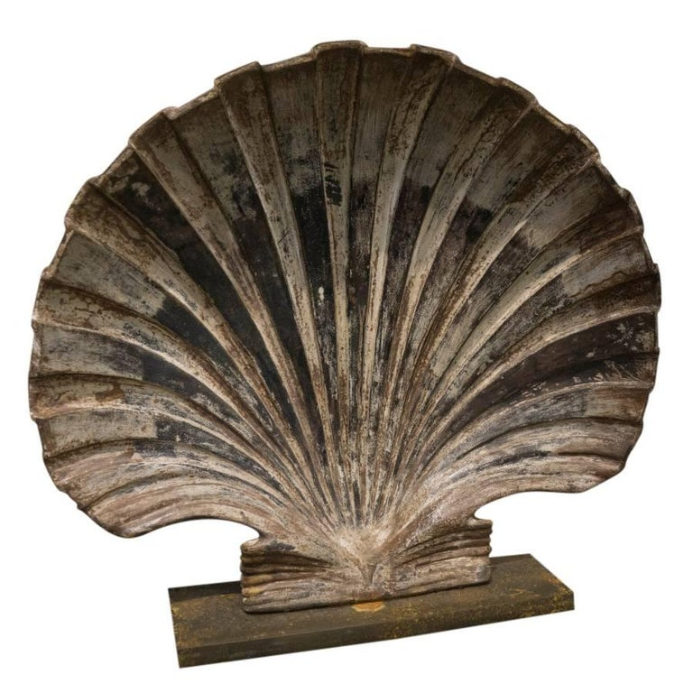 This beautiful set of cast iron shells have a presence of depth and weight, a beautiful combination of age and style.