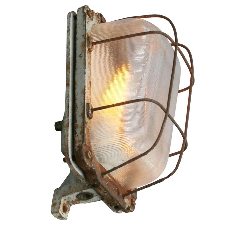 Industrial wall-ceiling scone cast iron ribbed clear glass  Weight: 4.50 kg / 9.9 lb  Priced per individual item. All lamps have been made suitable by international standards for incandescent light bulbs, energy-efficient and LED bulbs. E26/E27 bulb