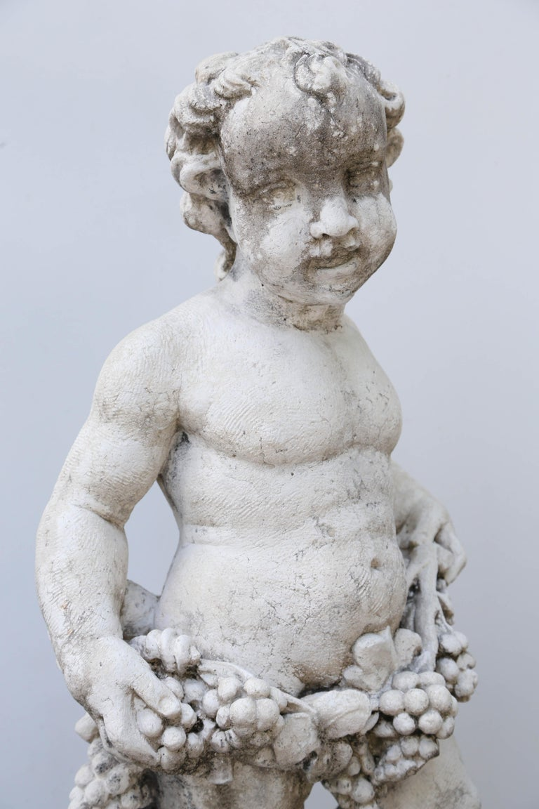 Cast Limestone Cherub Statue For Sale at 1stdibs