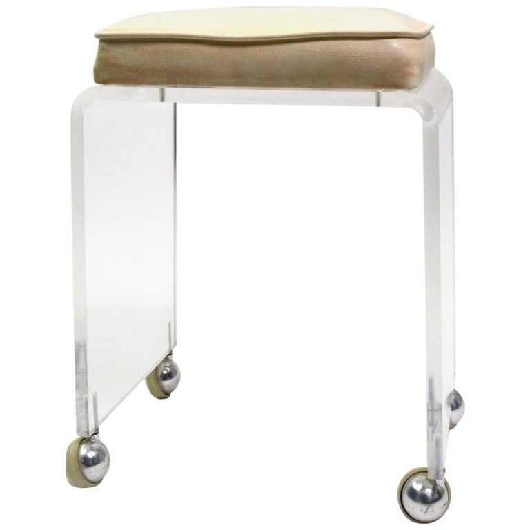 Cast Lucite Waterfall Bench Stool On Chrome Ball Caster
