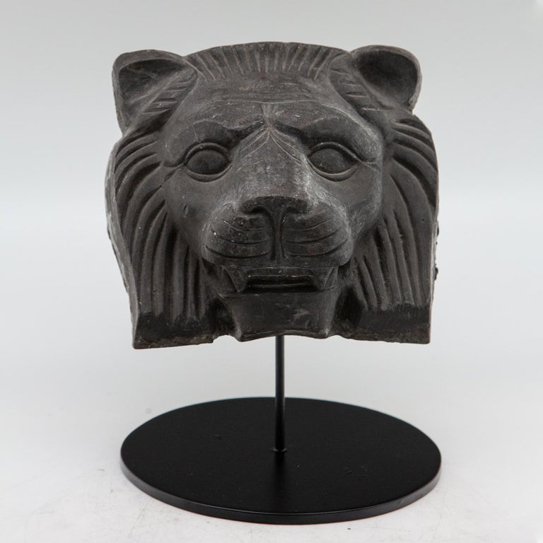 Cast metal lion head on custom black metal stand. Architectural element from a New York City Building from the late 19th-early 20th century. Measures: 7.5