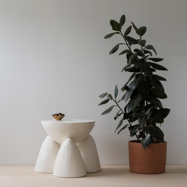 The Twyla-03 side table is four unique hand cast plaster forms that nestle together to form side table. Please note that this side table version is smaller and more compact than the Twyla-03 occasional table. Each piece is made by hand by and signed