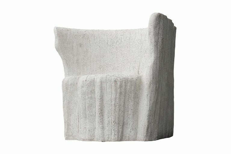 The mold for this Acacia chair was created from an actual tree stump. Pictured in our natural stone finish, the texture and modern look of concrete make it appropriate for a wide variety of styles and spaces.  Dimensions: Width 37 in. (94 cm), depth