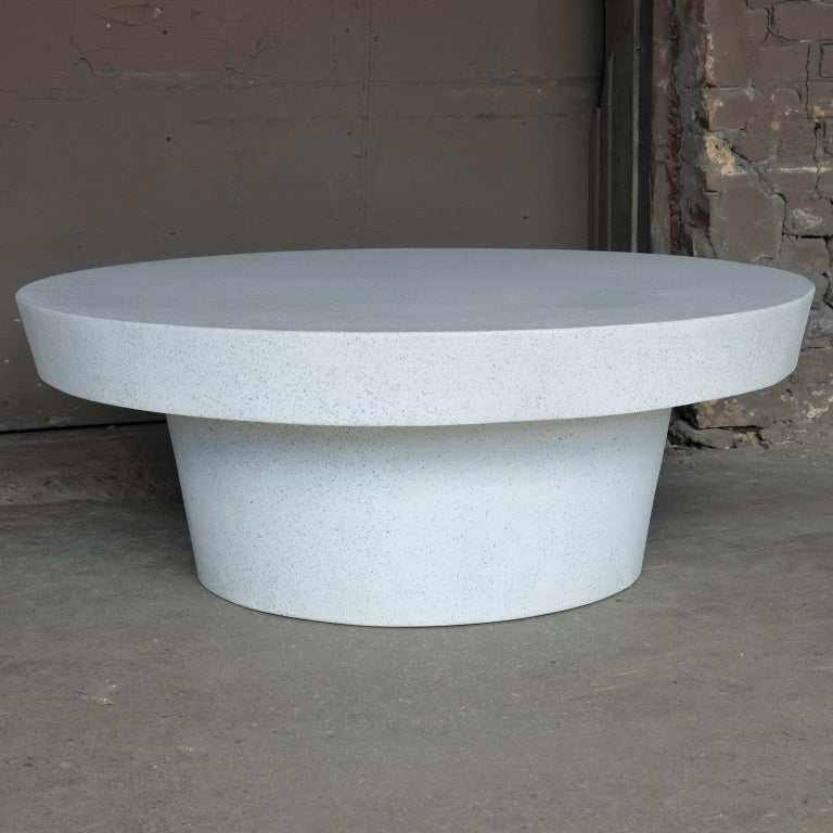 A place of balance and equilibrium. A smooth, beveled edge gently guides the eye around the form, showcasing its fields of stone aggregate.  Dimensions: Diameter 45 in. (114 cm). Height 16 in. (41 cm). Weight 85 lbs. (38.5 kg).  Finish color