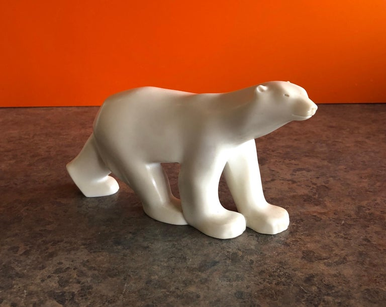 Cast resin polar bear sculpture by Francois Pompon for the MOMA Collection, circa 1984. The piece is a minature reproduction of the famous work by Pompon and is stamped