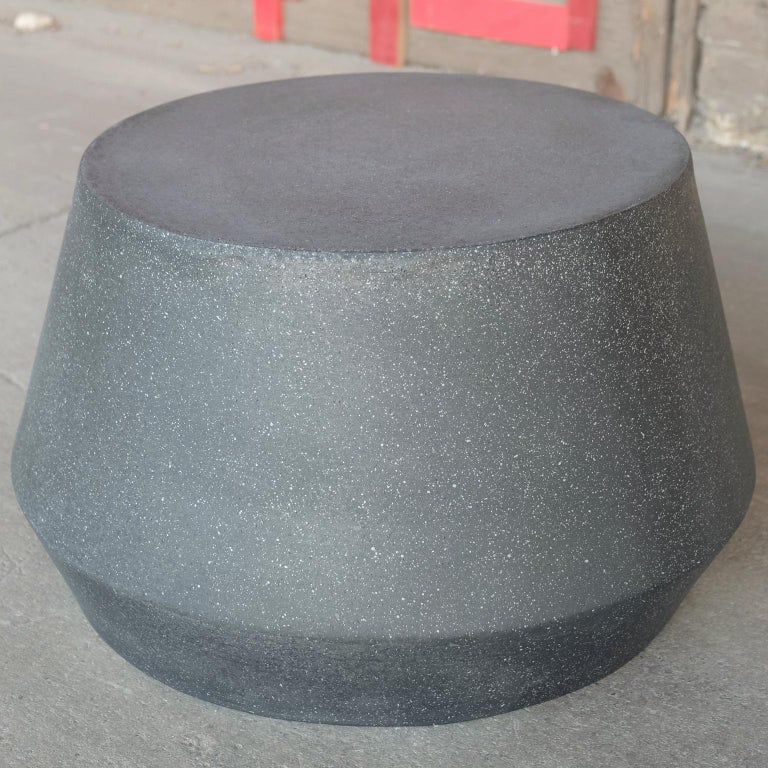 Elegantly playful and a bright complement.  Dimensions: Diameter 24 in. (61 cm), height 14 in. (36 cm), weight 20 lbs. (9 kg)  Finish color options: White stone Natural stone Aged stone Keystone Coal stone (shown)  Materials: Resin, stone aggregate
