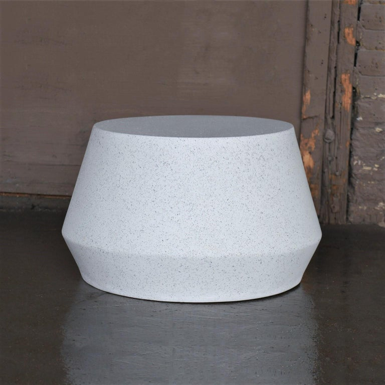 Elegantly playful and a bright complement.  Dimensions: Diameter 24 in. (61 cm), height 14 in. (36 cm), weight 20 lbs. (9 kg)  Finish color options: White stone (shown) Natural stone Aged stone Keystone Coal stone  Materials: resin, stone