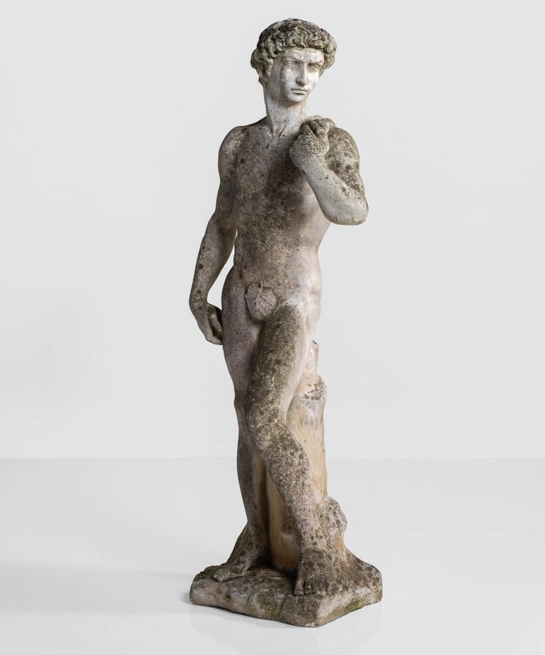 Cast stone statue, France, circa 1900.  With a beautiful patina in the style of Michelangelo's David.