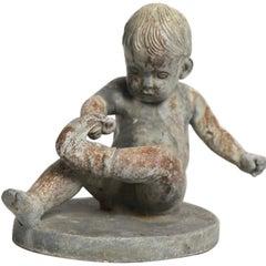 Cast Zinc Garden Figure Boy with Sock