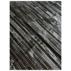 Castelluxe Gemma Design Black Hair on Hide Rug With Brass Tacks