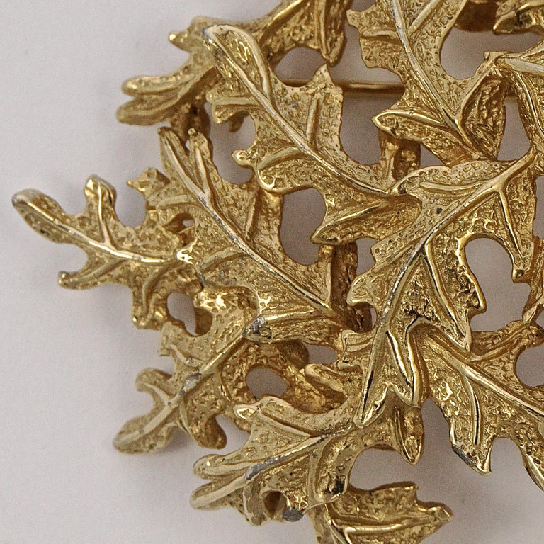 Castlecliff gold plated brooch with a lovely oak leaves design, it is slightly dome shaped. Measuring width 5.8cm / 2.28 inches by 4.5cm / 1.77 inches. The clasp works well.  This beautiful vintage statement brooch would look lovely for everyday