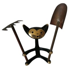 Cat Figurine with Shovel and Rake by Walter Bosse