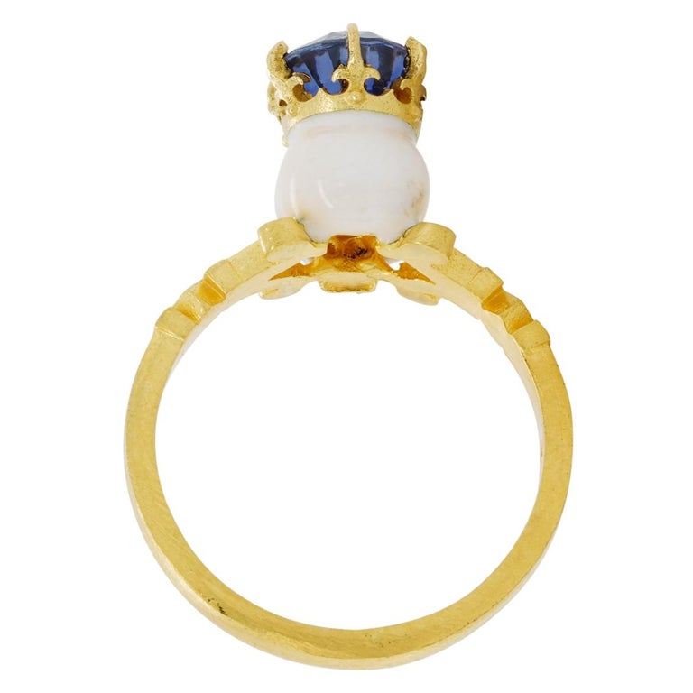 Oval Cut Catacomb Saint Skull Ring in 22 Karat Gold, Enamel and Violet Blue Sapphire For Sale