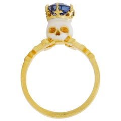 Catacomb Saint Skull Ring in 22 Karat Gold, Enamel and Violet Blue Sapphire