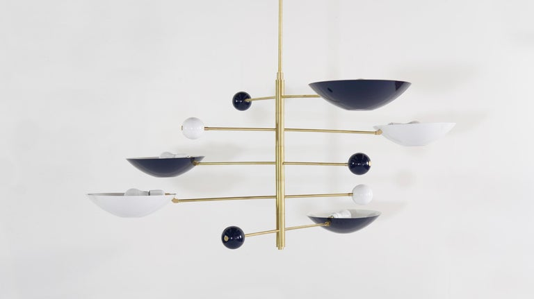 Catalonia is a commanding statement piece with design elements of both Italian and French modernism and is a stunning study in balance and equilibrium.  Shown in brass and