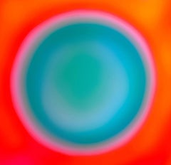 """Orb"", a pulsing turquoise circle surrounded by rings of pink and orange"