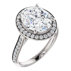 Cathedral Halo Forever One Oval Brilliant Moissanite Diamond Engagement Ring