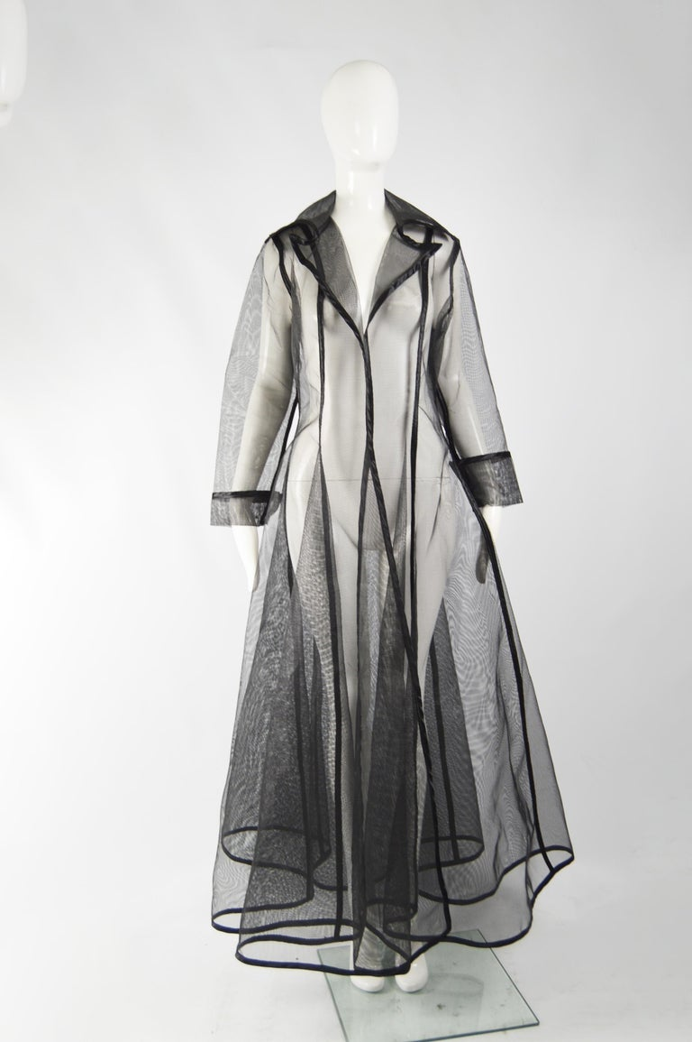 A dramatic and rare vintage see through maxi jacket from the 80s by iconic fashion designer, Catherine Coatney, known for her scupltural and bondage inspired designs. It is made from a mesh that is so structured that it almost stands up by itself,