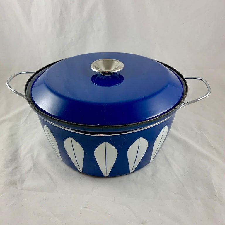 An enamelware Lotus pattern Dutch oven manufactured by the Norwegian manufacturer Cathrineholm. Cathrineholm operated from 1907-1970. The popular Lotus line was designed by Grete Prytz Kittelsen and produced during the early to mid-1960s.  White