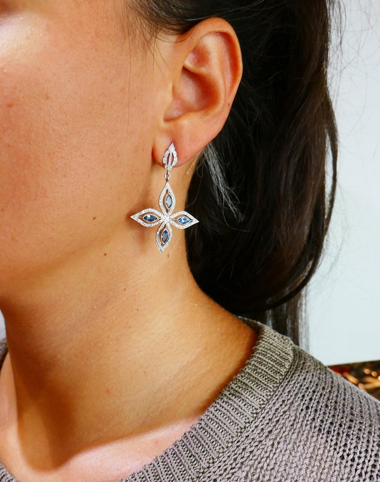Feminine and elegant dangle earrings created by Cathy Waterman. Floral design and beautiful color combination make the earrings a great addition to your jewelry collection.  The earrings are made of platinum, marquise cut blue topaz (total weight