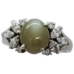 Cat's Eye Chrysoberyl Oval Cabochon and Diamond Cocktail Ring in Platinum