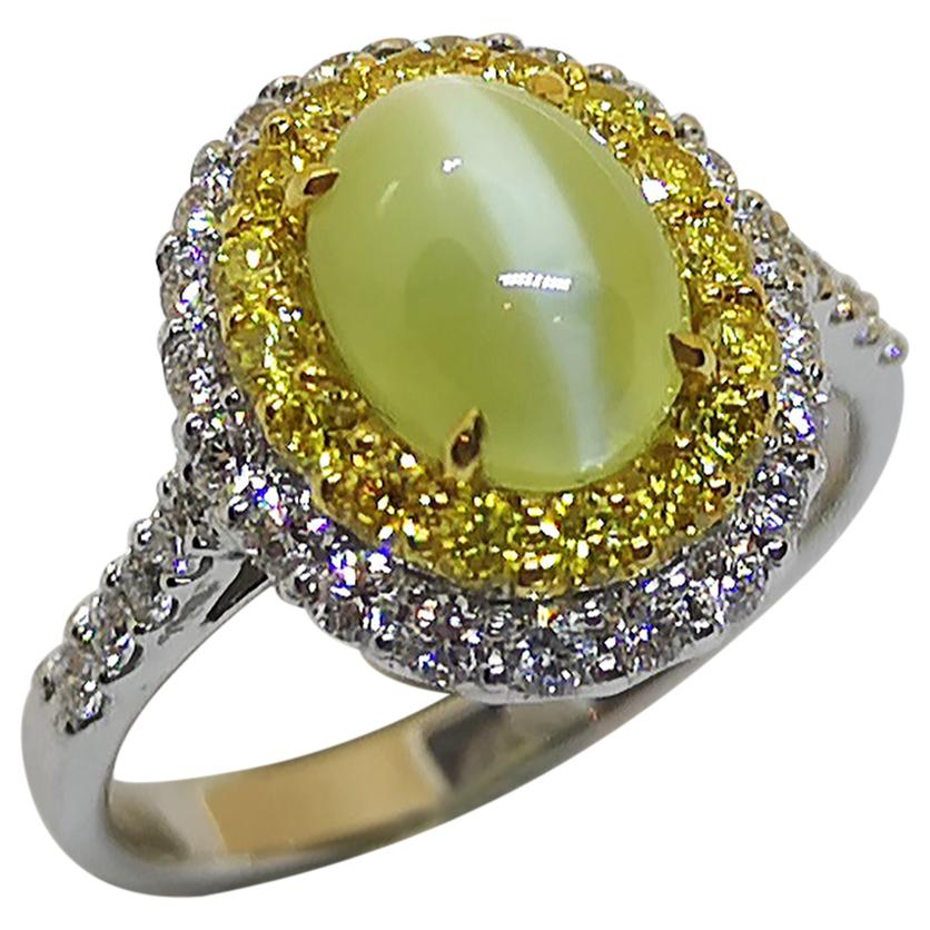 Cat's Eye Chrysoberyl with Yellow Diamond and Diamond Ring Set in 18 Karat
