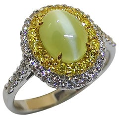 Cat's Eye Chrysoberyl with Yellow Diamond and Diamond Ring Set in 18 Karat
