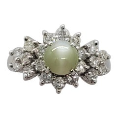 Cat's Eye Green Chrysoberyl Oval Cabochon and White Diamond Ring in Platinum