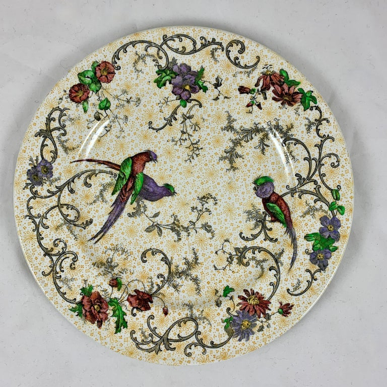 A set of four plates in the chinoiserie 'Bird of Paradise' pattern by Cauldon Potteries Ltd., Hanley, Staffordshire, England, circa 1905- 1920.  Cauldon was established in 1774 and continued operating until its acquisition by Coalport China Ltd in