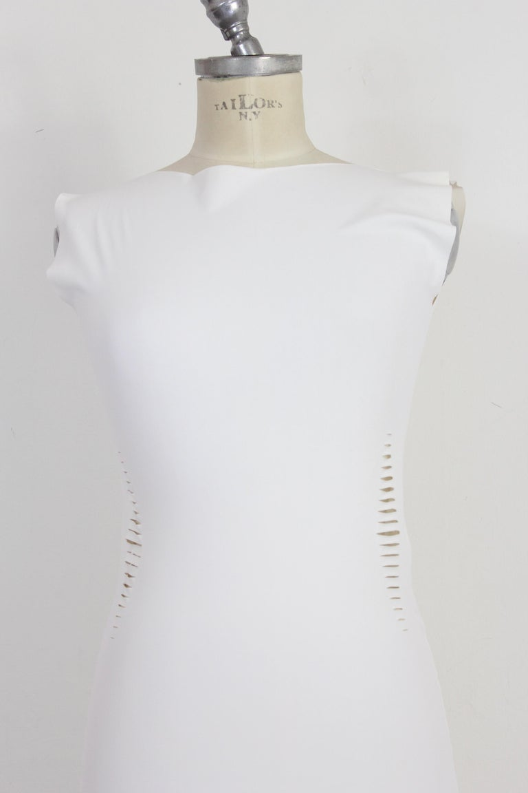 Cavalli Freedom 2000s woman dress. Fitted sheath dress, white, transparent. Laser cut all over the dress. Fabric 72% polyamide 28% elastane. Made in Italy. In the photos a card has been inserted to show the fit of the dress at its best.  Condition: