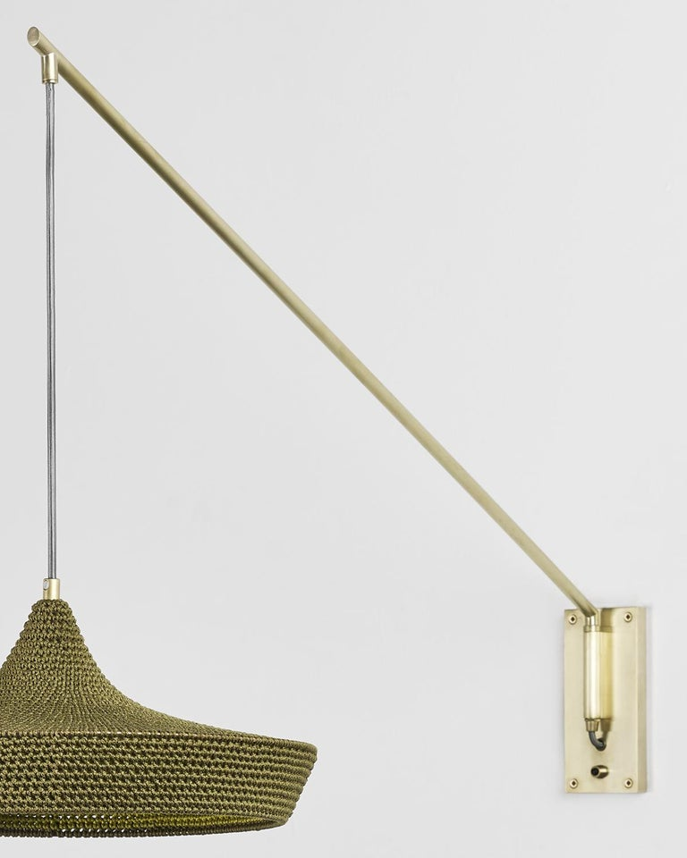 A direct light source, pivoting left and right for easy adjustment of light focus. Perfect for a social environment. Reaching over a dining table or accompanying an arm chair, to create an inviting space within a space.   Each Naomi Paul pendant and