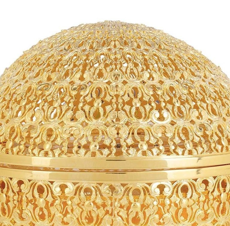 Inspired by the lavish tableware pieces from the Florentine Renaissance, this caviar bowl with a hinged lid of the Caterina de' Medici collection will be a stunning addition to a formal dinner. Handcrafted of bronze with 24-karat gold-plating, the