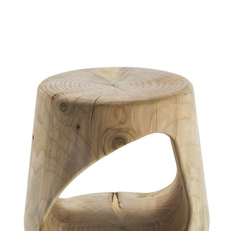 Stool cavity in solid natural aromatic cedar wood. Made in one block of cedar wood. Solid cedar wood include movement,  cracks and changes in wood conditions,  this is the essential characteristic of natural  solid cedar wood due to natural