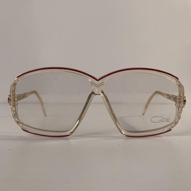 MATERIAL: Acetate COLOR: Clear MODEL: 153 GENDER: Adult Unisex SIZE: 59/8 Condition NOS (NEW OLD STOCK) - Never Worn or Used - They will come with a GENERIC Case Measurements TEMPLE MAX. LENGTH: 130 mm EYE / LENS MAX. WIDTH: 59 mm EYE / LENS MAX.