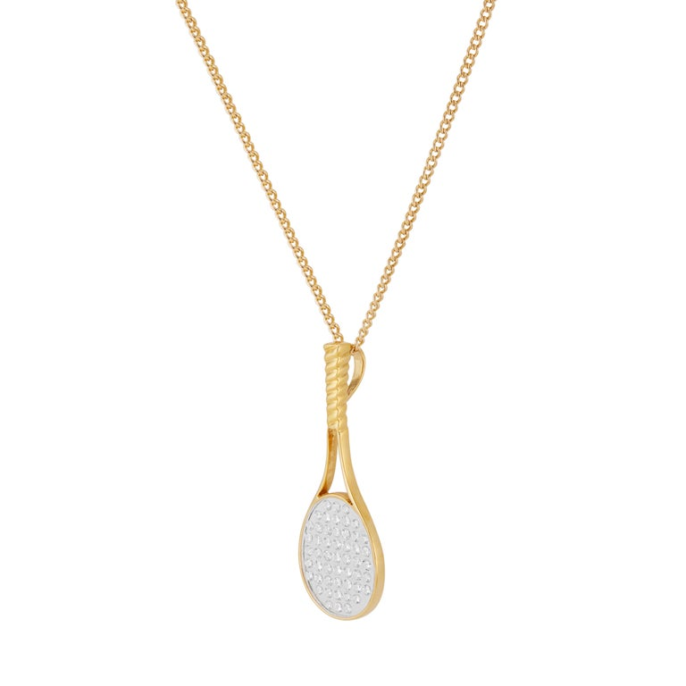 Designer CBI 18k yellow gold diamond tennis racket pendant necklace. 51 brilliant cut diamonds encased in clear Lucite in 18k yellow gold. 18 inches long.   51 round brilliant cut diamonds, F-G SI approx. .50cts 18k yellow gold  Stamped: 18k 4.8