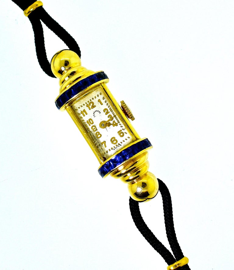C.D. Peacock, a fine and collected early 20th century watch company has made this ladies wristwatch which has a strong retro, Art Moderne, design.  There are 18 natural French cut sapphires, probably unheated Burma stones, as evident of their fine