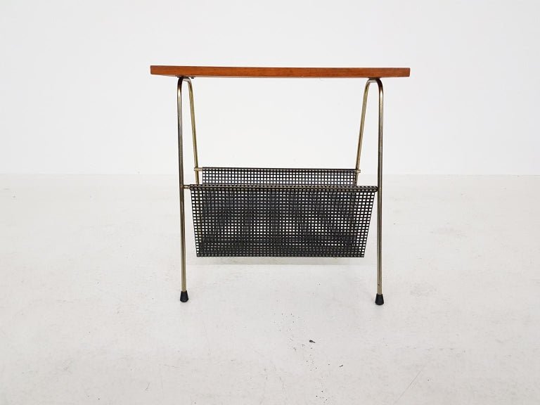 Nice side table or magazine rack. It has many similarities with the TM series side tables or magazine racks by Cees Braakman for Pastoe the Netherlands.  Cees Braakman was a Dutch furniture designer who worked for UMS Pastoe in the midcentury. He