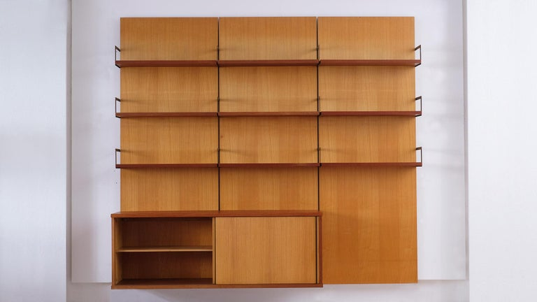 Rare and beautiful wall unit with back panels in ash and contrasting teak shelves and sideboard designed by Cees Braakman for UMS Pastoe, Utrecht, 1958.