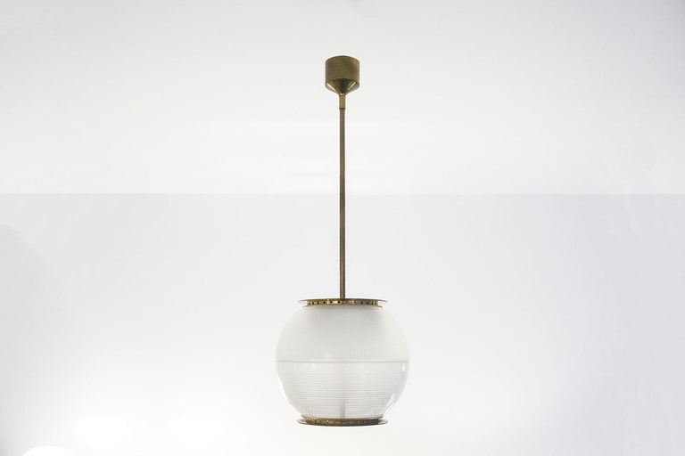 Ceiling lamp, model 'LP8' Brass construction and pressed glass in two pieces Dimensions / H.100 ø26cm Design / Ignazio Gardella 1950 Manufacturer / Azucena  2 pieces available.