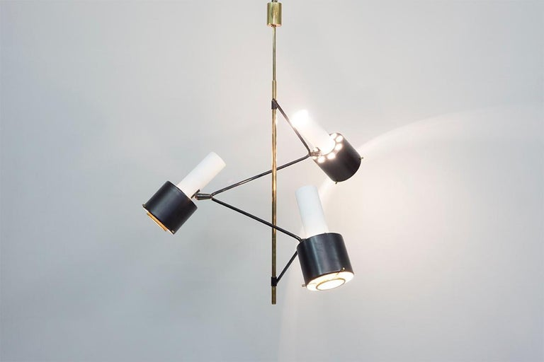 Ceiling lamp with a brass construction partly lacquered black