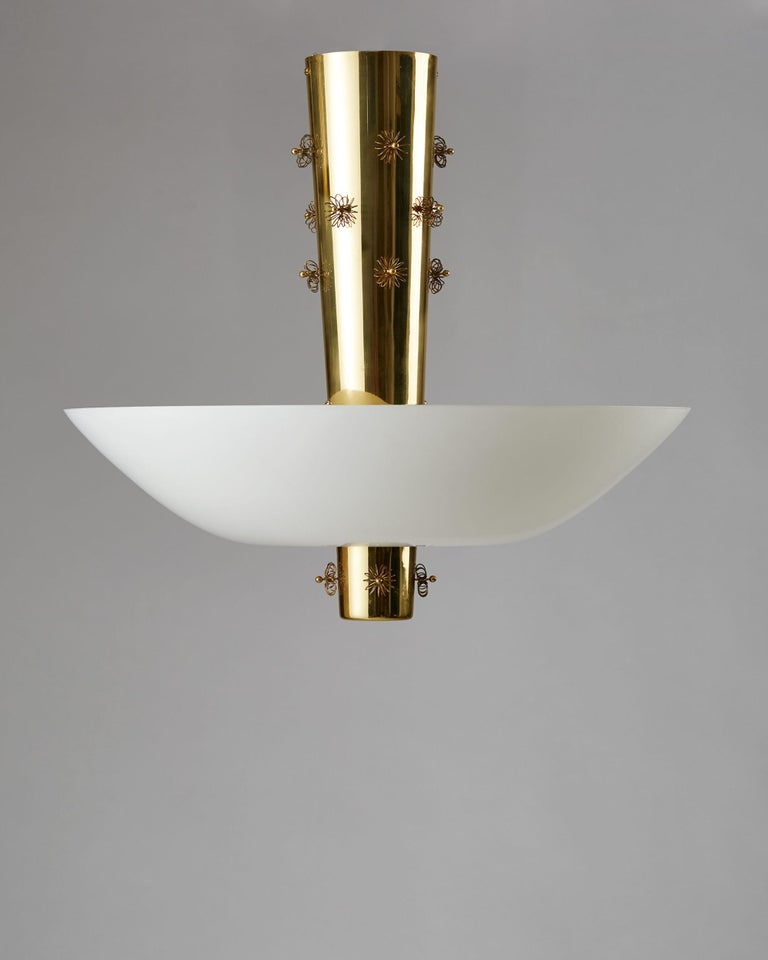 Ceiling lamp designed by Paavo Tynell for Taito Oy, Finland, 1950s. Brass and opaline glass.  Measures: H 57.5 cm/ 1' 11