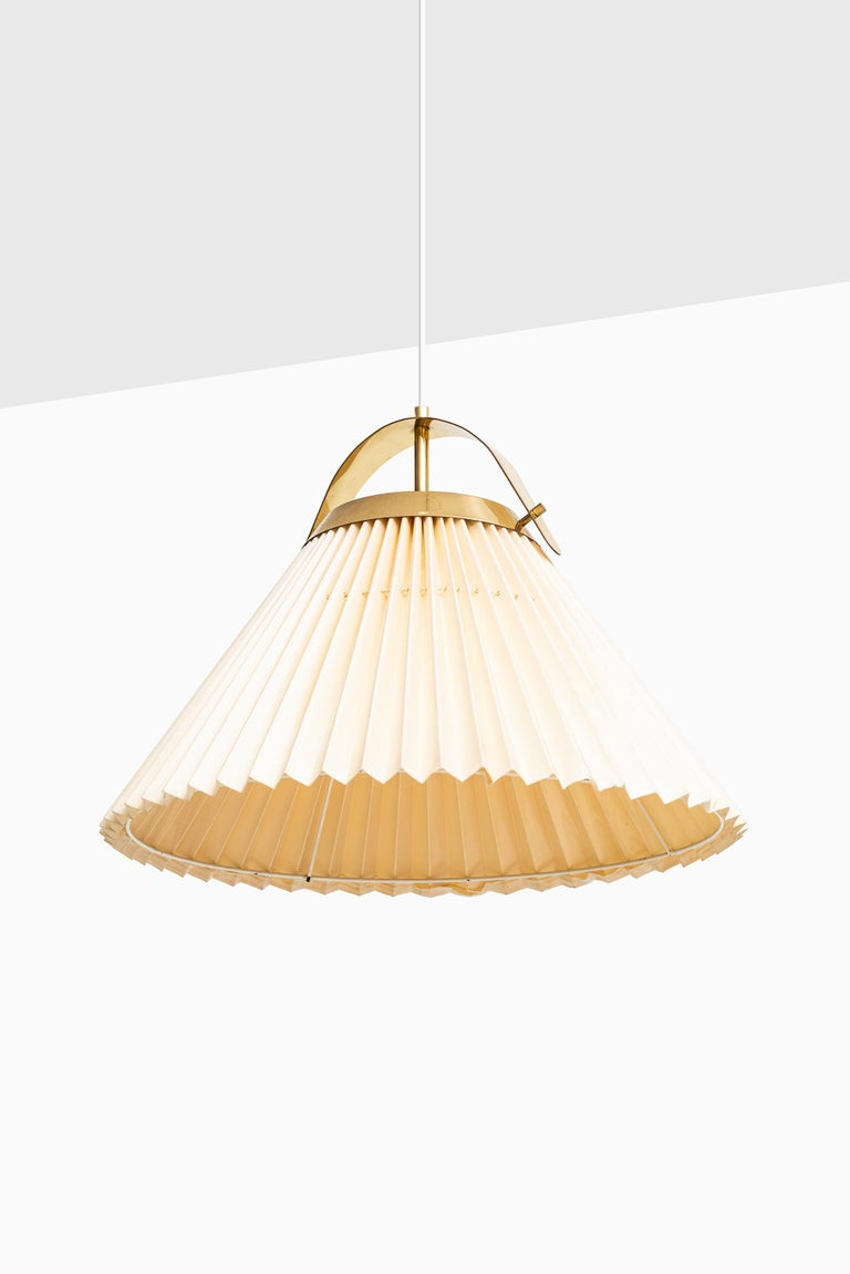 Rare ceiling lamp in brass and original shade. Produced by Bergbom in Sweden.