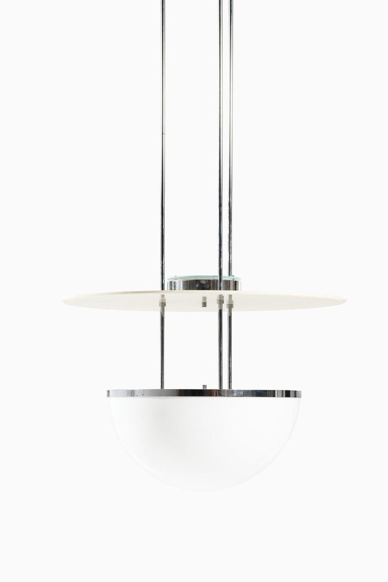 Rare and large ceiling lamps by unknown designer. Produced by Nybro Armaturfabrik in Sweden.