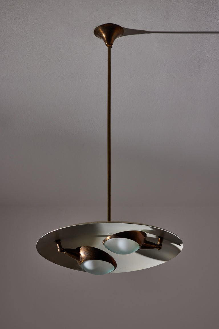 Ceiling light by Stilnovo. Manufactured in Italy, circa 1950's. Enameled metal, brass, glass. Wired for U.S. standards. Original canopy, custom brass backplate. We recommend two E14 60w maximum candelabra bulbs. Bulbs provided as a one time courtesy.