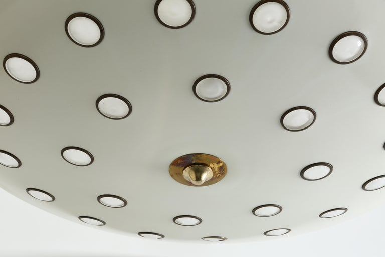Ceiling pendant by Lumen.