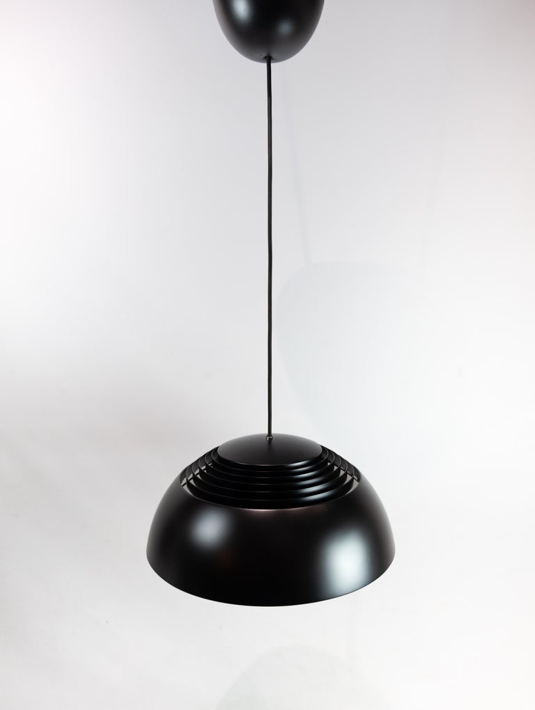 Ceiling pendant, Royal, in black metal designed by Arne Jacobsen and manufactured by Louis Poulsen. The lamp is in great vintage condition.